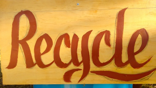 """They needed """"Recycle"""" signs so I found a piece of wood then Hand wrote and painted on the spot."""