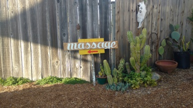 """They needed """"massage"""" signs so I found a piece of wood then Hand wrote and painted on the spot."""